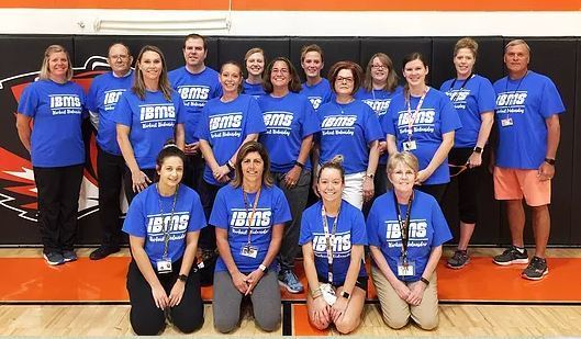 IBMS Teachers sporting their new workout shirts